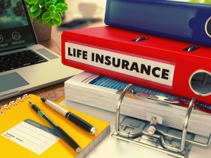 Life Insurance binder and paperwork on the desk of a Chicago Accidental Death Insurance Lawyer